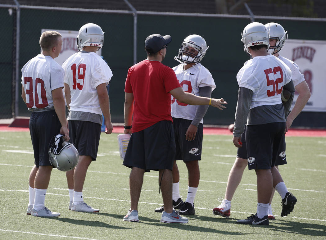 UNLV special team quality control Brandon Roberts, center, talks to players, including kicker Evan Pantels (30), defensive back Malachi Miles (19) and line backer Cooper Minich (52) during team pr ...