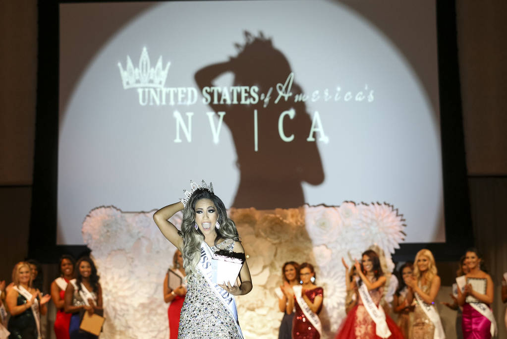 Las Vegas resident Bianca Gaden, 23, reacts as she walks the runway after being crowned Miss Southern Nevada during the inaugural United States Of America Miss Nevada and Miss California pageant a ...