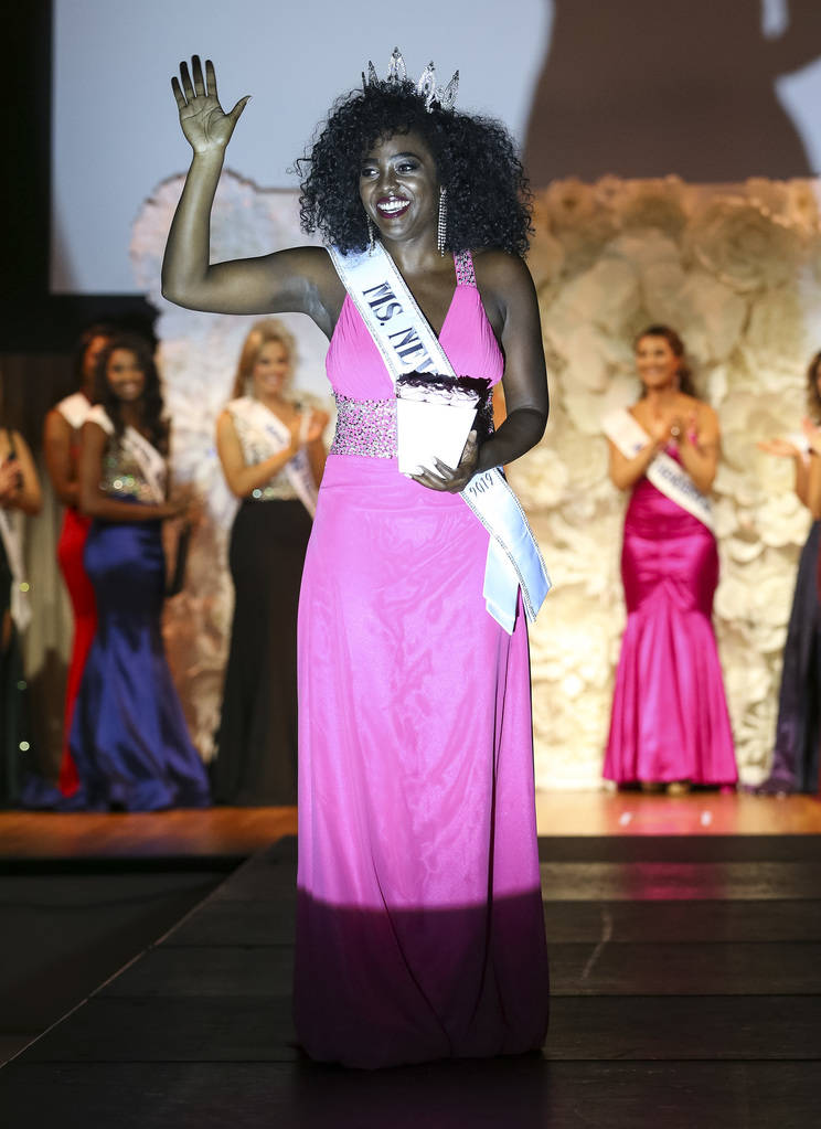 Yanne Givens of North Las Vegas waives to the crowd as she walks the runway after being crowned Ms. Nevada during the inaugural United States Of America Miss Nevada and Miss California pageant at ...
