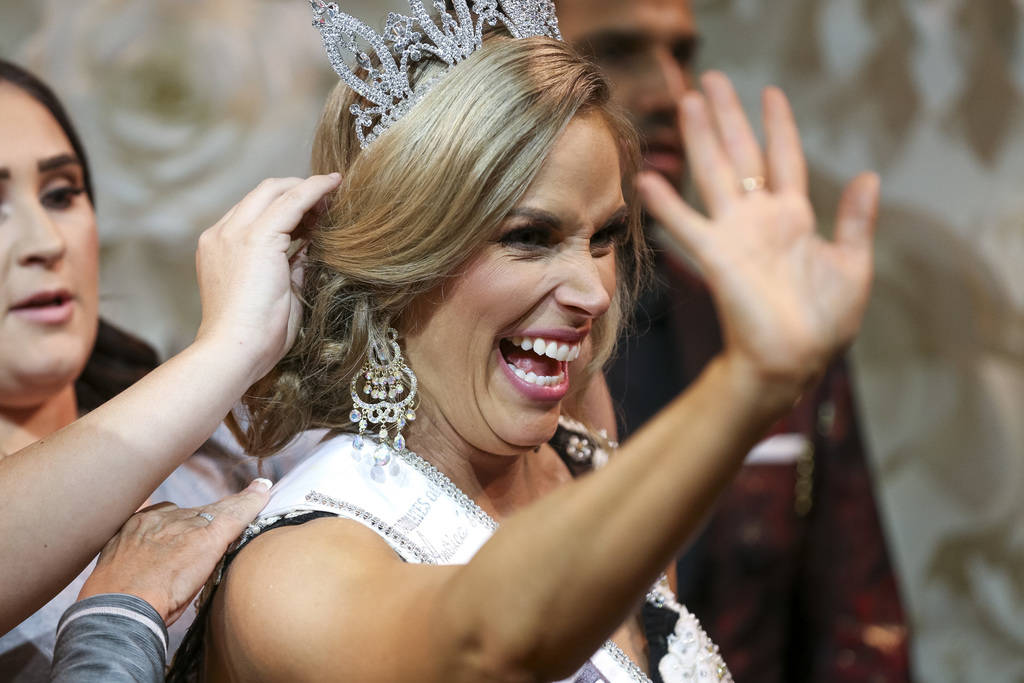 Mrs. Nevada winner Katie Ladomerszky waives to family members in the audience as she gets her hair touched up on stage after being crowned during the inaugural United States Of America Miss Nevada ...