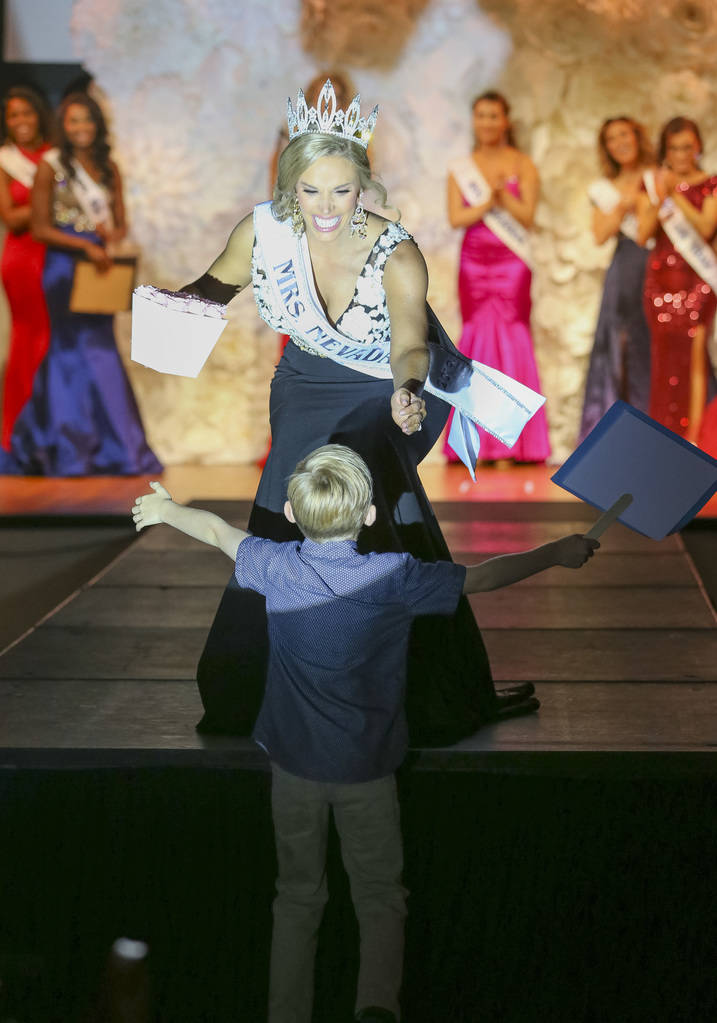 Mrs. Nevada winner Katie Ladomerszky goes to hug her seven-year-old son, Nico, who ran up to the stage to greet her after she was crowned during the inaugural United States Of America Miss Nevada ...
