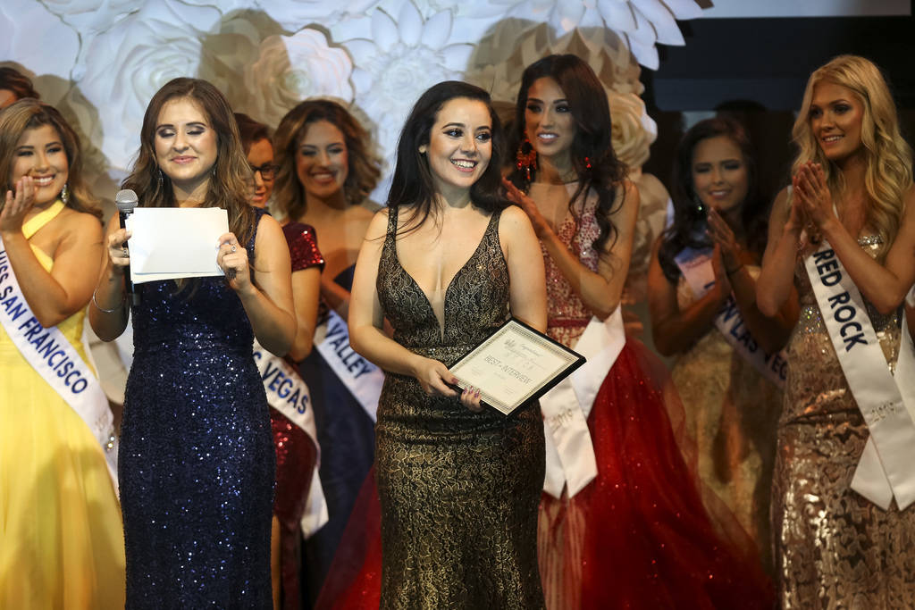 Sadda Shaker, co-director for the United States of America Miss Nevada and Miss California beauty pageants, presents an award onstage during the inaugural pageant at the Conference Center of Las V ...