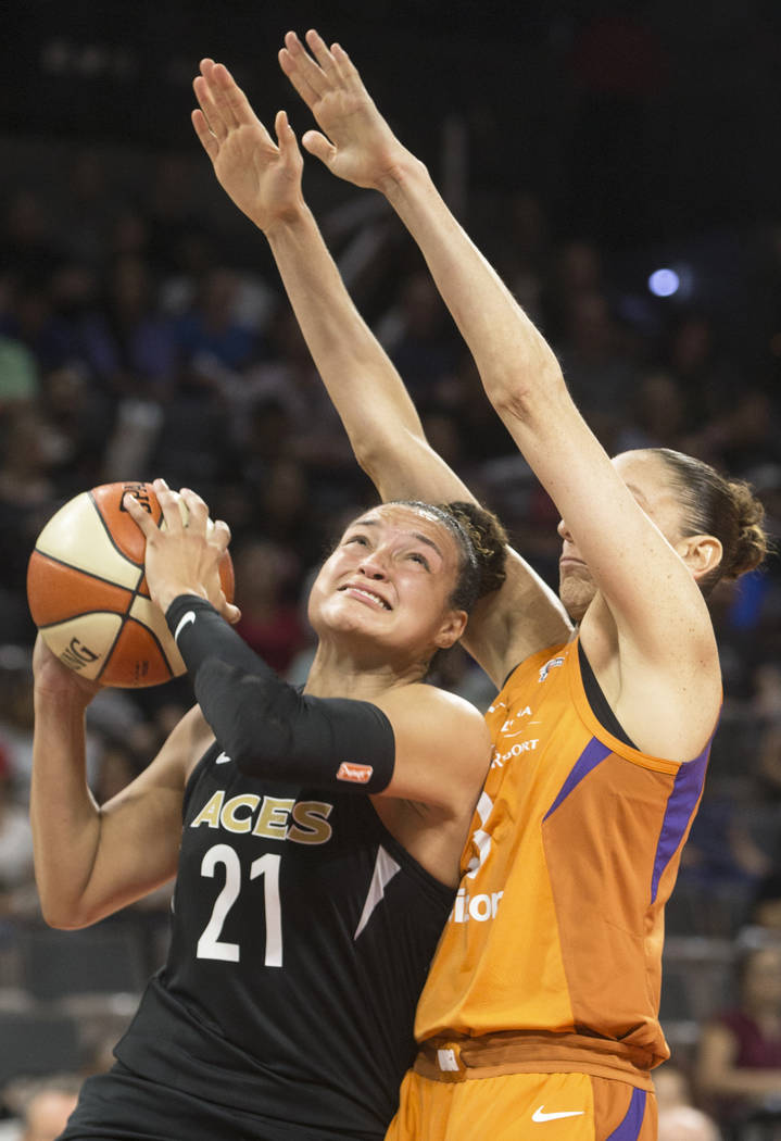 Aces guard Kayla McBride (21) drives past Phoenix Mercury guard Diana Taurasi (3) in the second quarter on Wednesday, August, 1, 2018, at the Mandalay Bay Events Center, in Las Vegas. Benjamin Hag ...