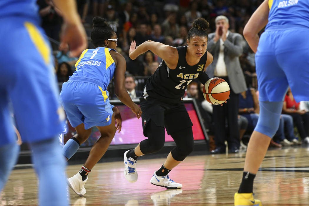 Las Vegas Aces guard Kayla McBride (21) drives past Chicago Sky guard Diamond DeShields (1) during the second half of a WNBA basketball game at Mandalay Bay Events Center in Las Vegas on Thursday, ...