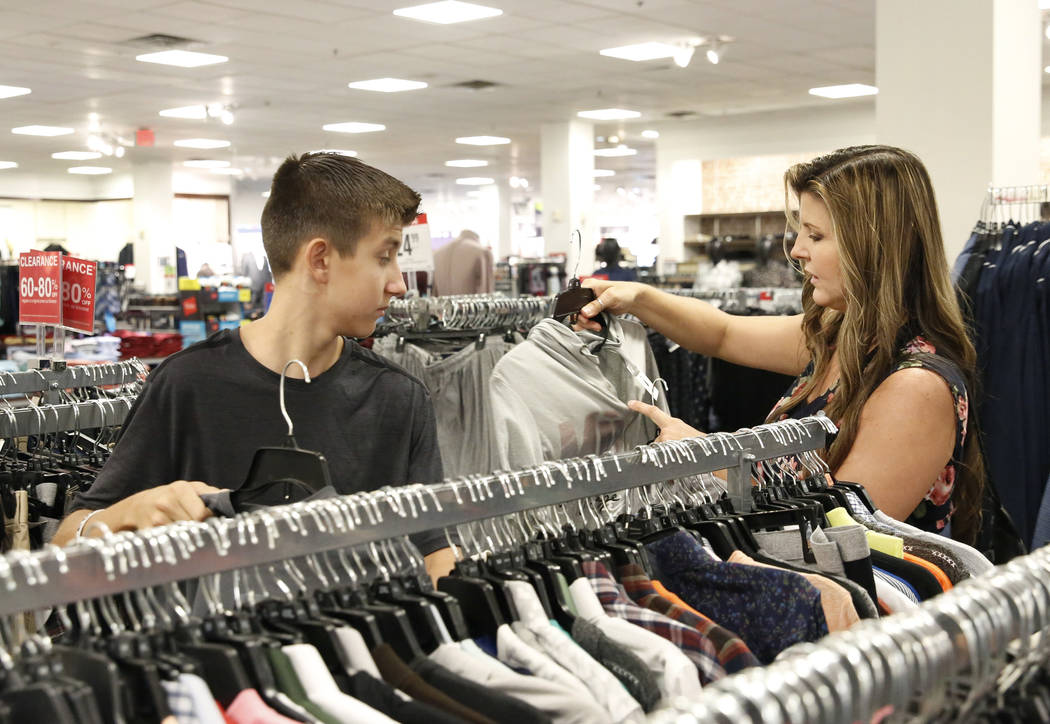 Levi Cartwright, 13, does his back to school shopping with his mother Christine at JCPenny on Thursday, Aug. 2, 2018, in Henderson. Bizuayehu Tesfaye/Las Vegas Review-Journal @bizutesfaye