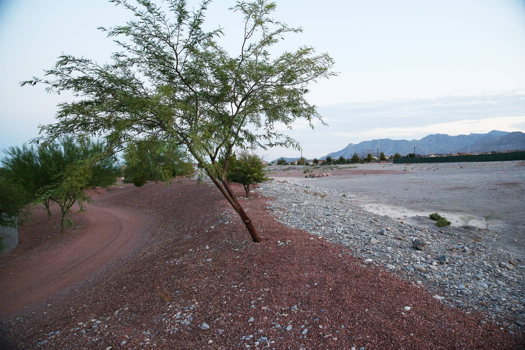 Red rock divides Huckleberry Park and the undeveloped park expansion site in the Providence master-planned community in Las Vegas, Monday, July 30, 2018. The Providence Master Homeowners Associati ...
