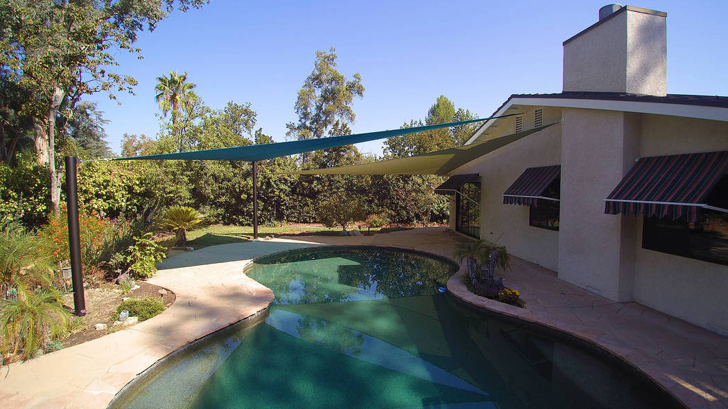 Shade sails are perfect for offering shelter over swimming pools. (Got Shade)
