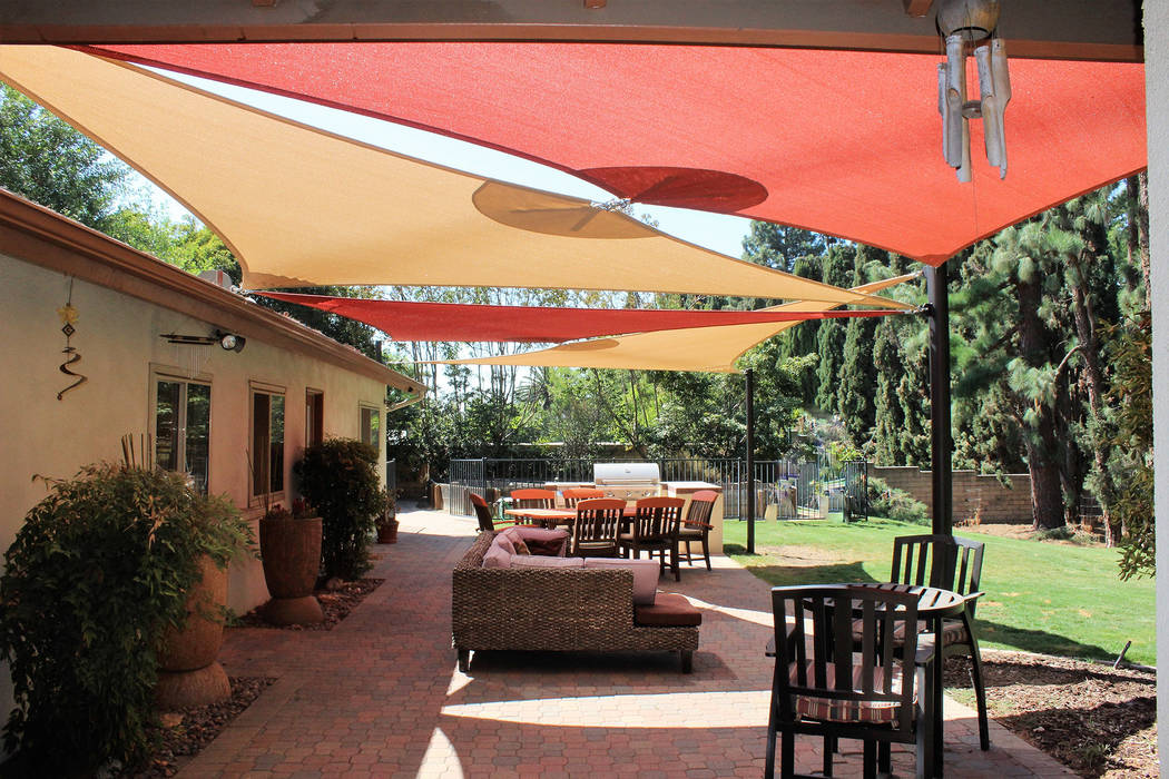 Shade sails add elegance and a contemporary look and can be a cost-effective way to provide shade vs. standard construction practices. (Got Shade)