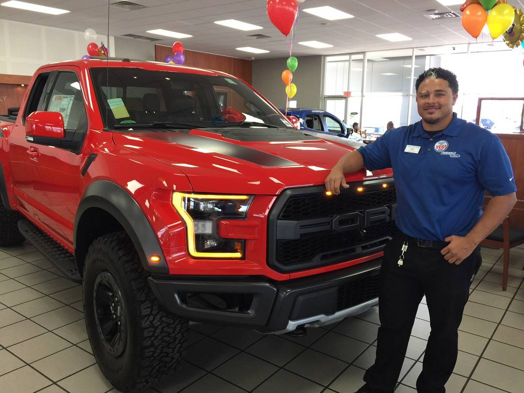 Friendly Ford sales consultant Sheldon Pyke is seen with the 2018 Ford Raptor pickup at the dealership located at 660 N. Decatur Blvd. (Friendly Ford)