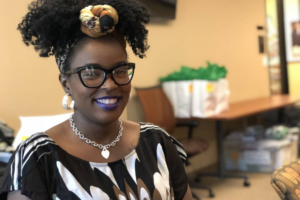 Shanice Stevens, a 29-year-old Las Vegas Valley native, organizes materials for Junior Achievement volunteers on June 27, 2018 in Henderson. She was recently hired to help boost the number of volu ...