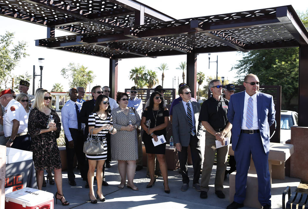 Guests attend the official opening of Purple Heart Plaza at 101 Market St. in downtown Henderson on Tuesday, Aug. 7, 2018. (Bizuayehu Tesfaye/Las Vegas Review-Journal) @bizutesfaye