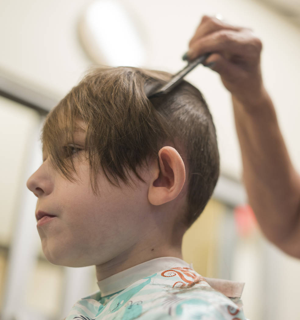 Sylas Fayne, 4th grade, gets a free haircut for his school supply donation at My Salon Suite in Las Vegas, Sunday, Aug. 5, 2018. (Marcus Villagran/Las Vegas Review-Journal) @brokejournalist