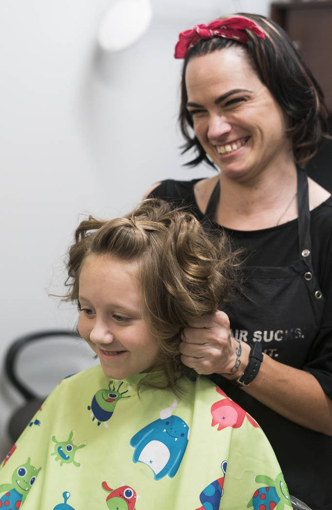 Dayla Chasez, 2nd grade, gets a free haircut from Crystal Lafortune at My Salon Suite in Las Vegas, Sunday, Aug. 5, 2018. (Marcus Villagran/Las Vegas Review-Journal) @brokejournalist