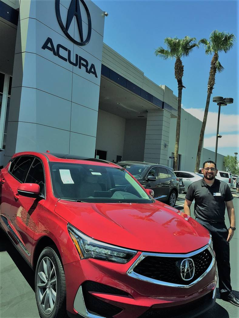 Findlay Acura sales consultant Travis Aguilar shows off the 2019 Acura RDX Crossover at the dealership at 315 Auto Show Drive in the Valley Automall. (Findlay)