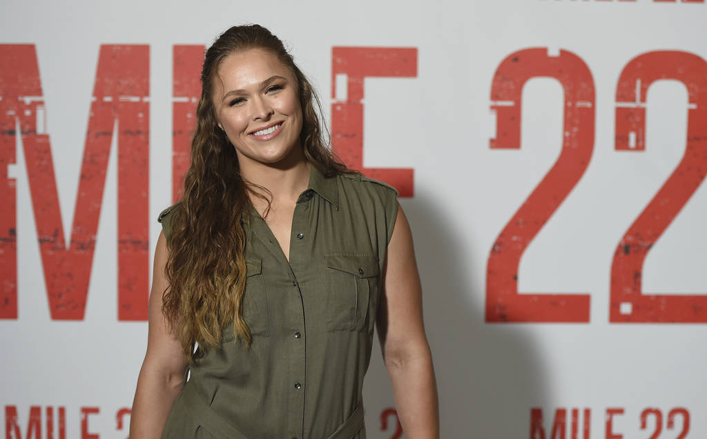 """Cast member Ronda Rousey attends a """"Mile 22"""" photo call at the Four Seasons Hotel on Saturday, July 28, 2014 in Los Angeles. (Photo by Jordan Strauss/Invision/AP)"""