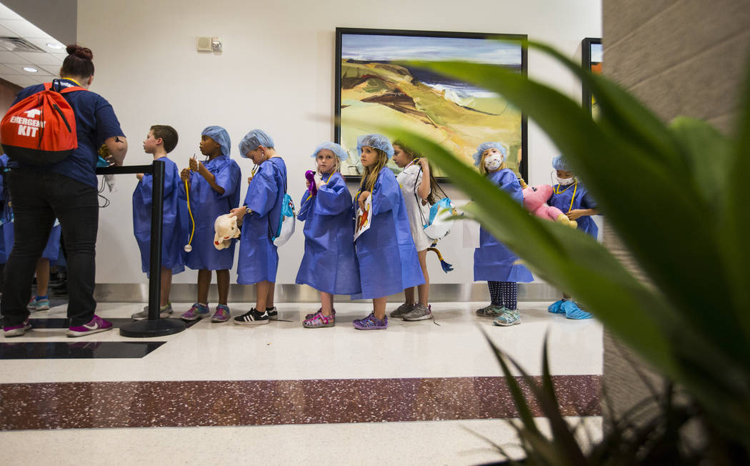 Children dressed in scrubs line up during the Teddy Bear Clinic event at Centennial Hills Hospital in Las Vegas on Wednesday, Aug. 1, 2018. Chase Stevens Las Vegas Review-Journal @csstevensphoto