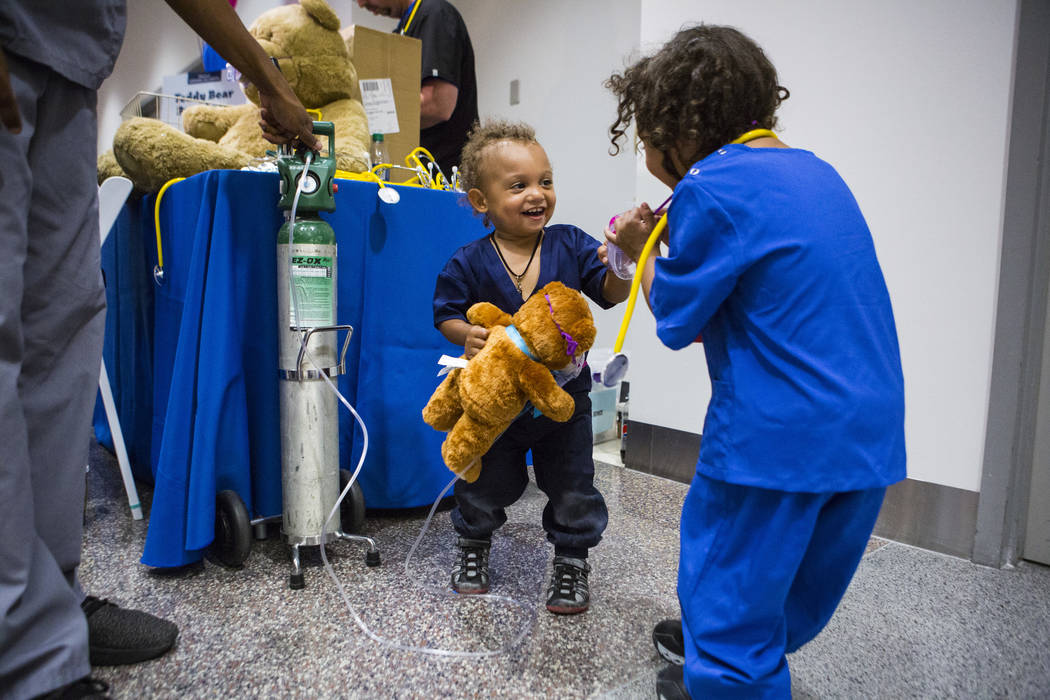 Christopher Nelson, 1, interacts with his brother David, 3, at the respiratory station during the Teddy Bear Clinic event at Centennial Hills Hospital in Las Vegas on Wednesday, Aug. 1, 2018. Chas ...