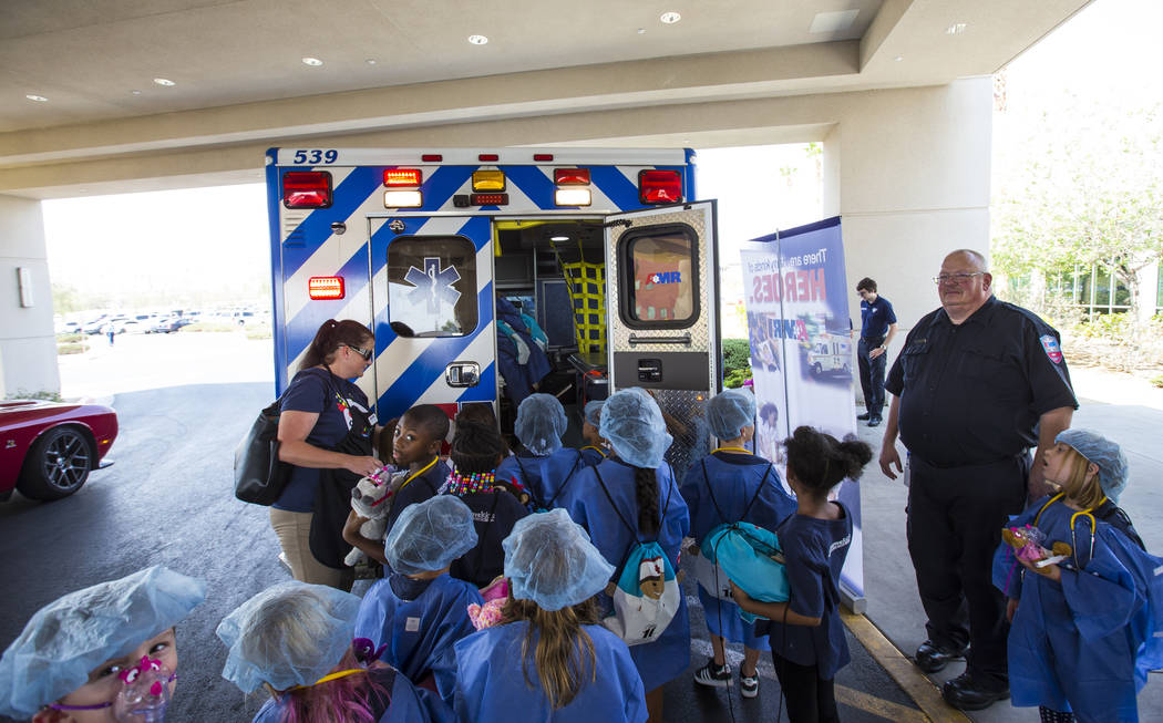 Children check out an ambulance during the Teddy Bear Clinic event at Centennial Hills Hospital in Las Vegas on Wednesday, Aug. 1, 2018. Chase Stevens Las Vegas Review-Journal @csstevensphoto