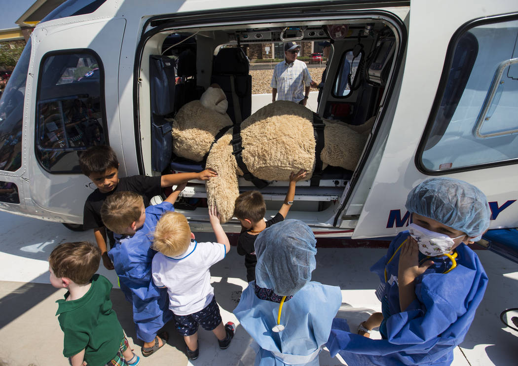 Children touch a teddy bear in a Mercy Air helicopter during the Teddy Bear Clinic event at Centennial Hills Hospital in Las Vegas on Wednesday, Aug. 1, 2018. Chase Stevens Las Vegas Review-Journa ...