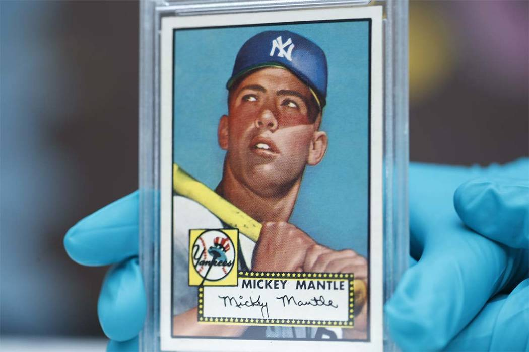 """The """"Holy Grail"""" of baseball cards, a 1952 Topps Mickey Mantle that is valued at more than $10 million, is put on display as part of baseball memorabilia exhibit at the Colorado History Museum Mon ..."""
