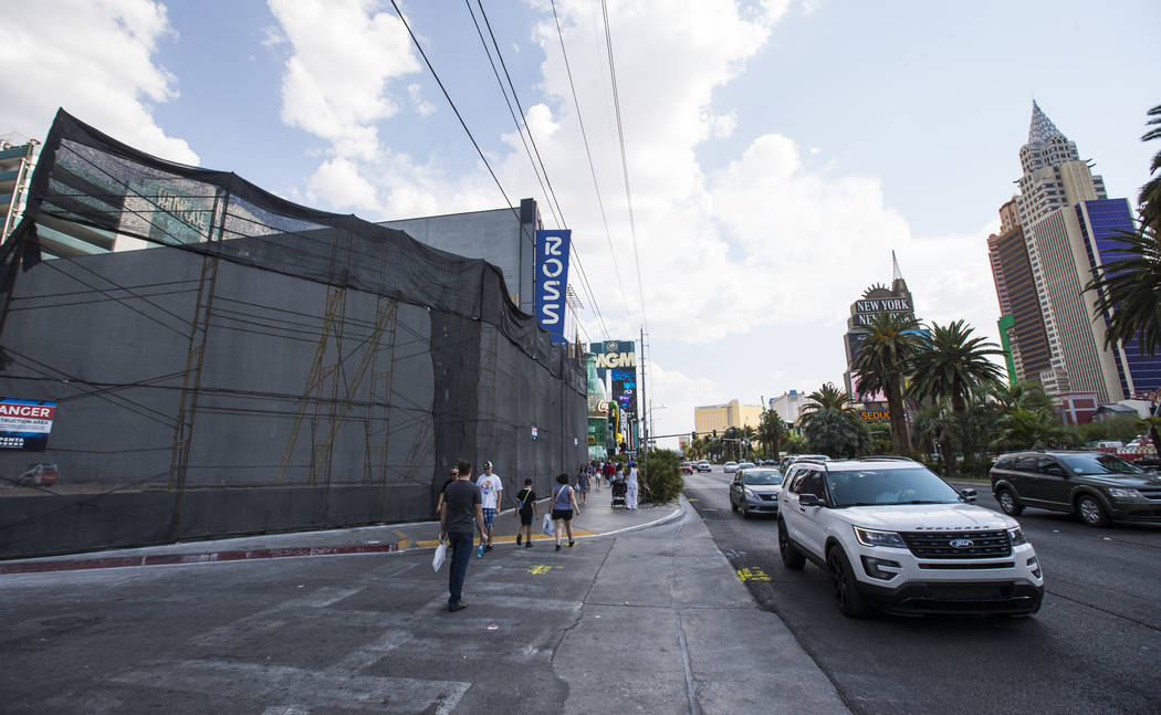 Pedestrians and traffic pass by the location where a Target is slated to open in 2020, adjacent to the Showcase Mall and the MGM Grand, on Las Vegas Boulevard on Wednesday, Aug. 1, 2018. The locat ...