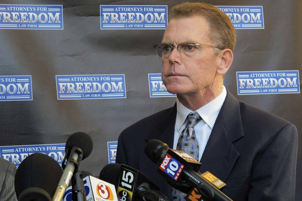Douglas Haig takes questions from reporters at a news conference in Chandler, Arizona, on Feb. 2, 2018. An Arizona judge imposed new limits on Haig, who was accused of providing armor-piercing amm ...