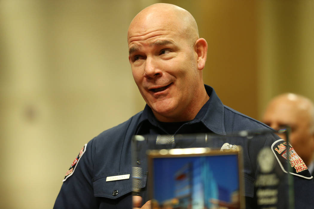 Las Vegas paramedic Matthew Driscoll is recognized as the employee of the month, during a city council meeting at Las Vegas City Hall in Las Vegas, Wednesday, Aug. 1, 2018. Erik Verduzco Las Vegas ...