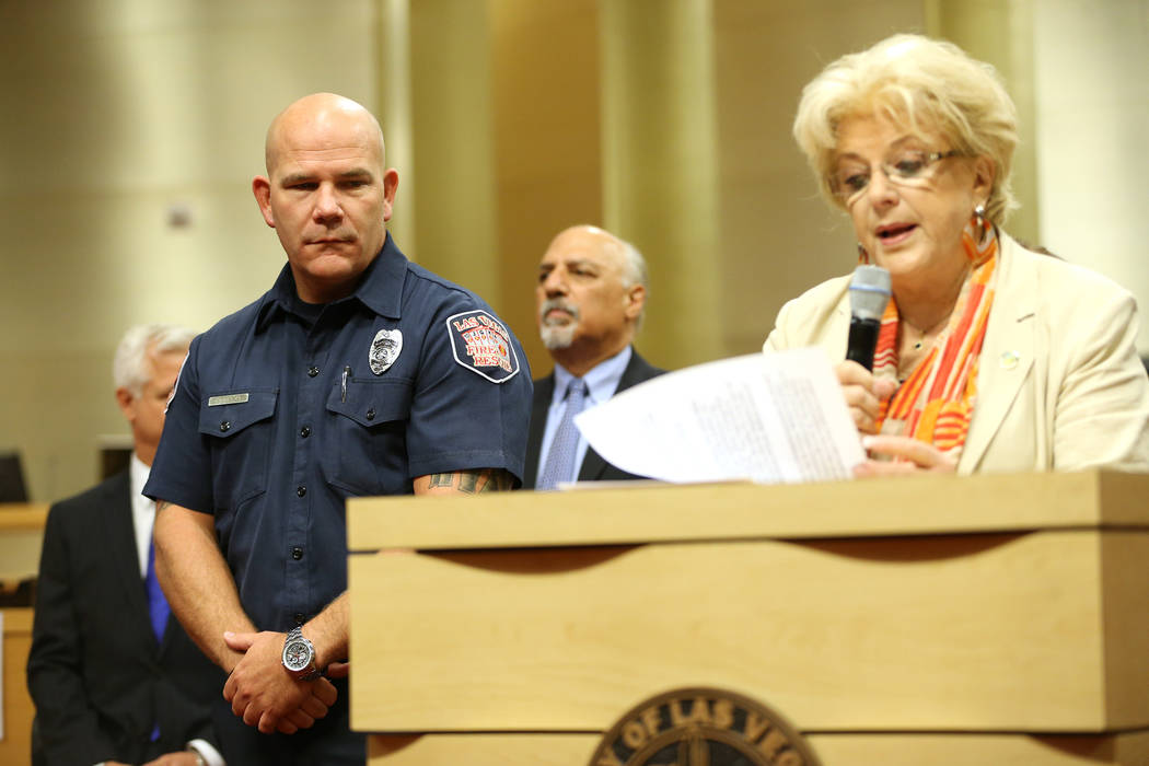 Las Vegas Mayor Carolyn Goodman, right, recognizes paramedic Matthew Driscoll as the employee of the month, during a city council meeting at Las Vegas City Hall in Las Vegas, Wednesday, Aug. 1, 20 ...