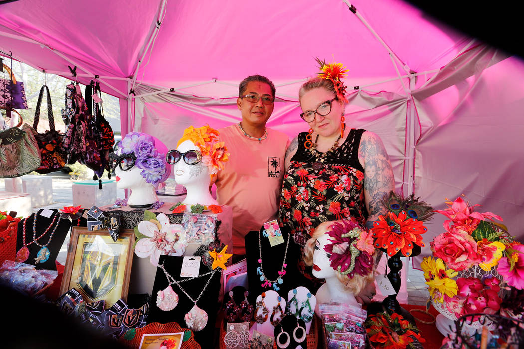 "Madison Morassi De Los Reyes and her husband Joseph pose for a photo while selling items at their tent, ""Princess Madison"" during First Friday Las Vegas, a monthly art festival, located ..."