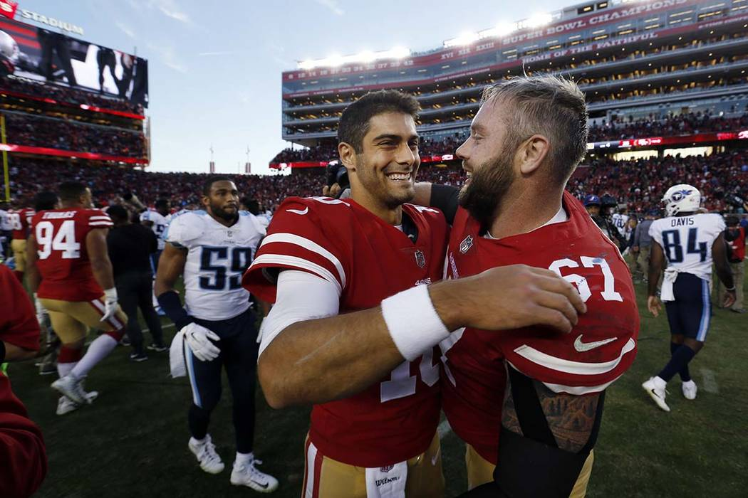 San Francisco 49ers quarterback Jimmy Garoppolo, center, hugs teammate Daniel Kilgore after a 25-23 win over the Tennessee Titans during an NFL football game Sunday, Dec. 17, 2017, in Santa Clara, ...