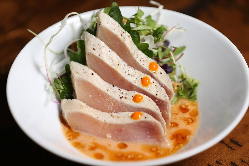 The albacore sashimi is served with seared albacore tuna, rocoto-ponzu, and popped quinoa, at Once restaurant at the Palazzo hotel-casino in Las Vegas, Wednesday, Aug. 1, 2018. Erik Verduzco Las V ...