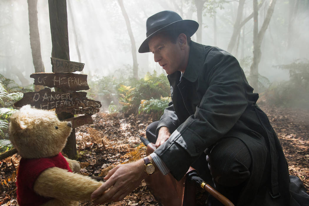 "Christopher Robin (Ewan McGregor) with his long time friend Winnie the Pooh in Disney's live-action adventure ""Christopher Robin."" Disney"