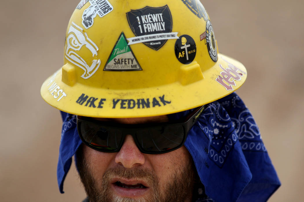Mike Yedinak works on Nevada Department of Transportation Project Neon on Interstate 15 between the Spaghetti Bowl and Sahara Avenue Thursday, Aug. 2, 2018. K.M. Cannon Las Vegas Review-Journal @K ...
