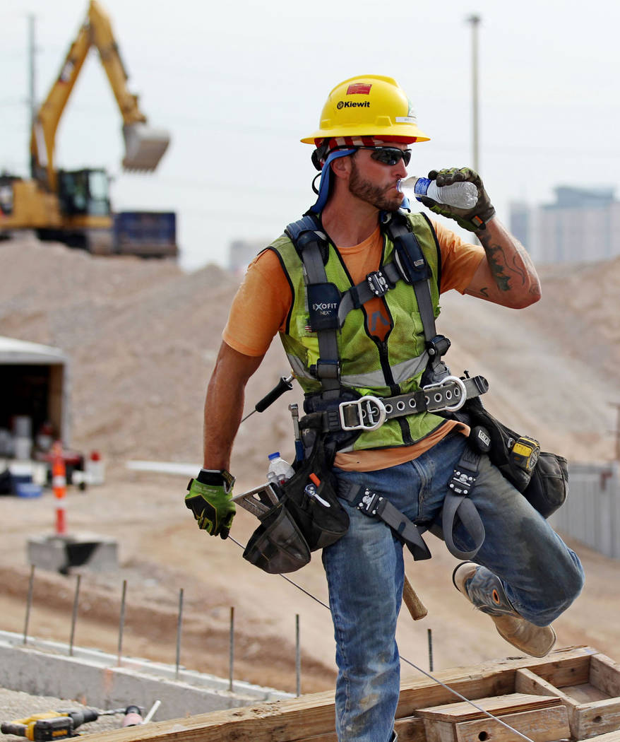 A worker drinks water while working on Nevada Department of Transportation Project Neon on Interstate 15 between the Spaghetti Bowl and Sahara Avenue Thursday, Aug. 2, 2018. K.M. Cannon Las Vegas ...