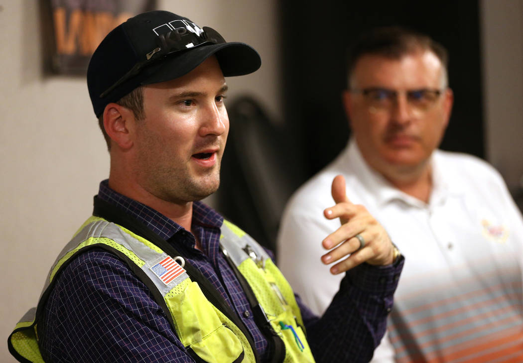 Kiewit's safety manager Robert Murphy, left, and public information officer Jay Proskovec, discuss heat safety for their workers in the Nevada Department of Transportation Project Neon at a Kiewit ...