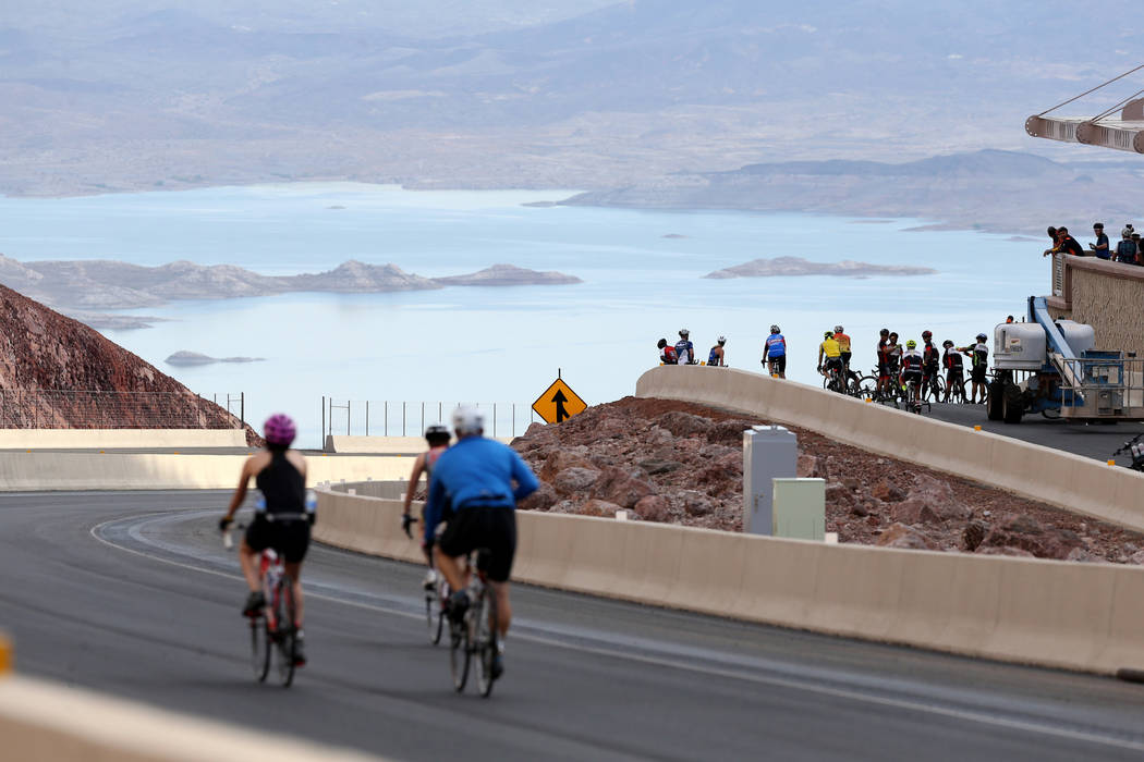 Cyclists check out the overlook above Lake Mead while riding on the yet-to-be-opened Interstate 11 in Boulder City Saturday, July 21, 2018. The event, sponsored by the Southern Nevada Bicycle Coal ...