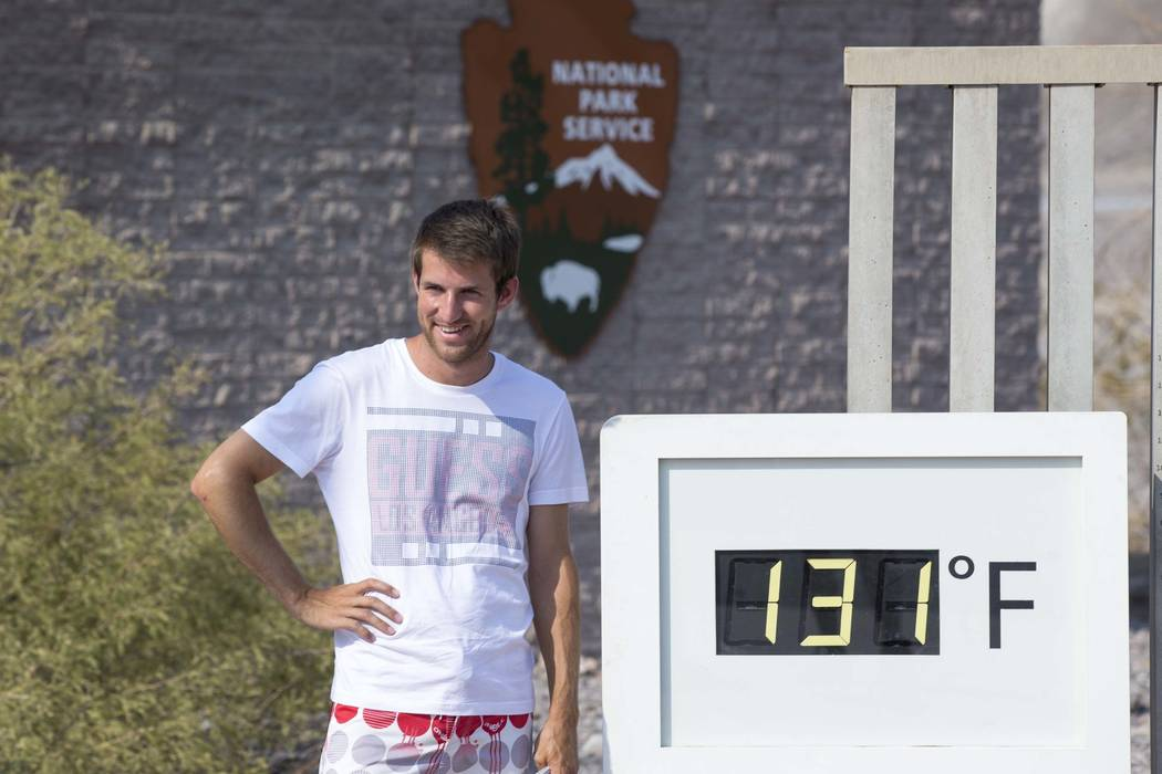 Luuk Broekhaus of the Netherlands poses at the Furnace Creek Visitor Center thermometer in Death Valley National Park, Calif., Thursday, July 26, 2018. Richard Brian Las Vegas Review-Journal @vega ...