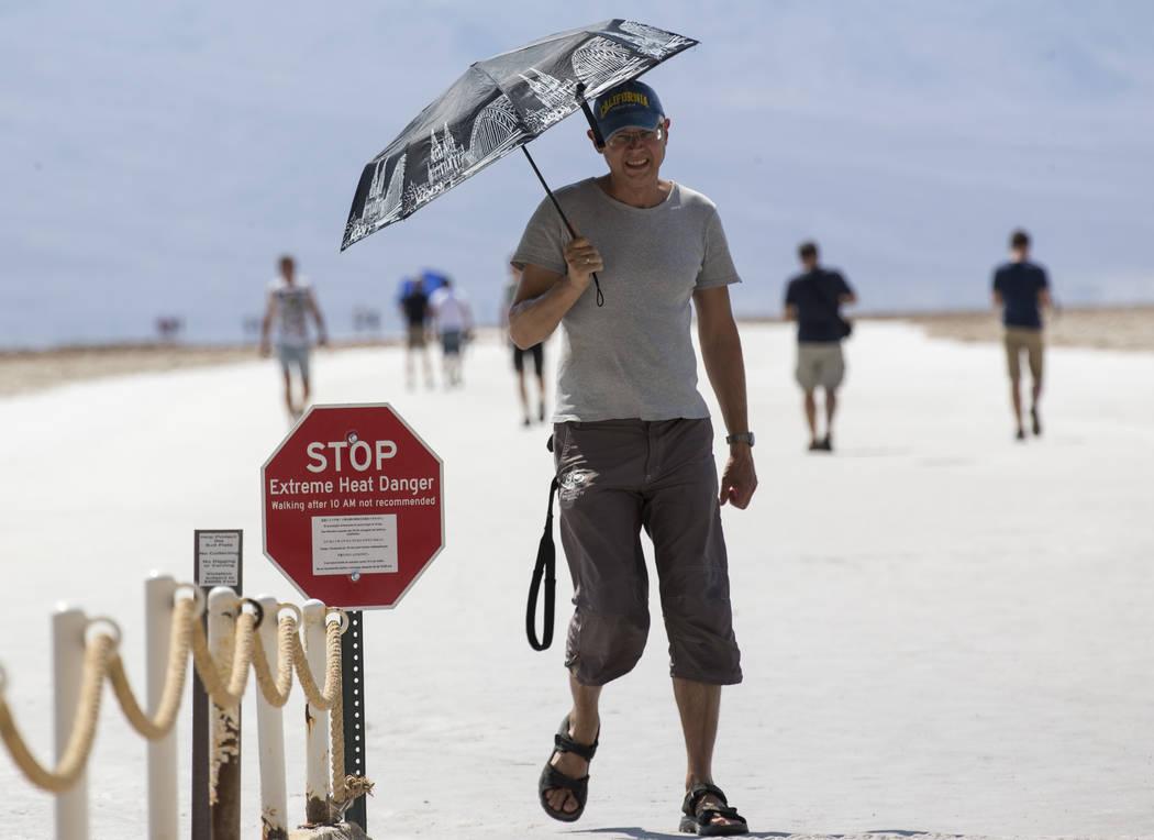 Valeriy Trushevskyy of Germany visits Badwater Basin, 282 feet below sea level, in Death Valley National Park, Calif., Thursday, July 26, 2018. Richard Brian Las Vegas Review-Journal @vegasphotograph