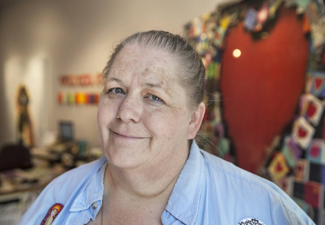 "Program wrangler Bobbie Ann Howell at the Nevada Humanities Program Gallery, which is hosting ""Hearts4Vegas,"" exhibiting cards, banners and other art work sent to Las Vegas after the Oct ..."