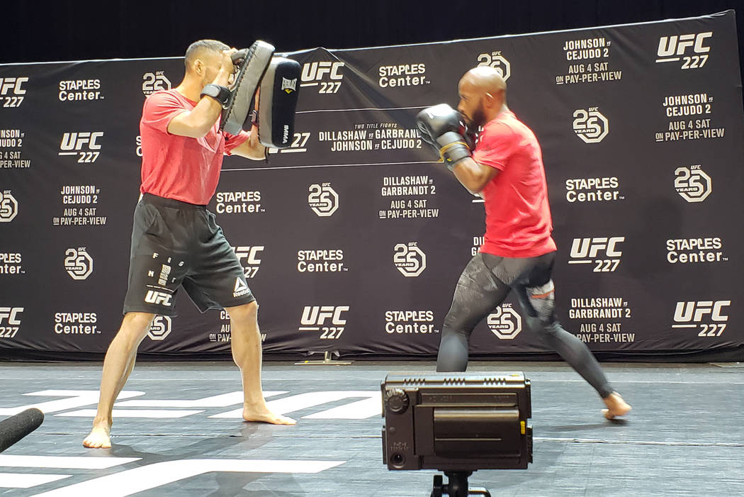 Demetrious Johnson, right, works out Wednesday at Novo Theater in Los Angeles. Adam Hill/Las Vegas Review-Journal