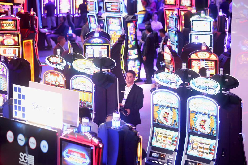 People check out slot machines in the Scientific Games booth during the Global Gaming Expo at the Las Vegas Sands Expo and Convention Center, Sept. 29, 2016. (Jeff Scheid/Las Vegas Review-Journal) ...