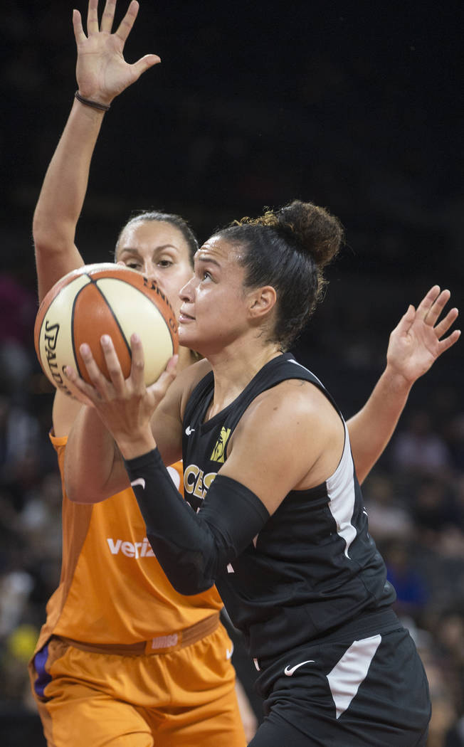 Aces guard Kayla McBride (21) drives past Phoenix Mercury guard Diana Taurasi (3) in the first quarter on Wednesday, August, 1, 2018, at the Mandalay Bay Events Center, in Las Vegas. Benjamin Hage ...