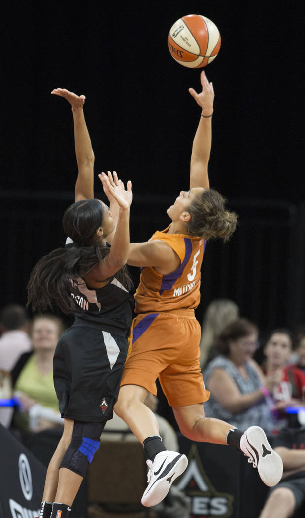 Phoenix Mercury guard Leilani Mitchell (5) shoots over Aces center A'ja Wilson (22) in the first quarter on Wednesday, August, 1, 2018, at the Mandalay Bay Events Center, in Las Vegas. Benjamin Ha ...