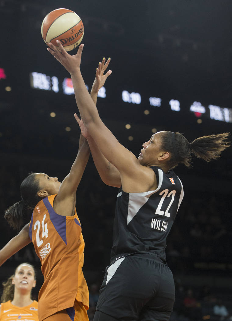 Aces center A'ja Wilson (22) drives past Phoenix Mercury forward DeWanna Bonner (24) in the second quarter on Wednesday, August, 1, 2018, at the Mandalay Bay Events Center, in Las Vegas. Benjamin ...