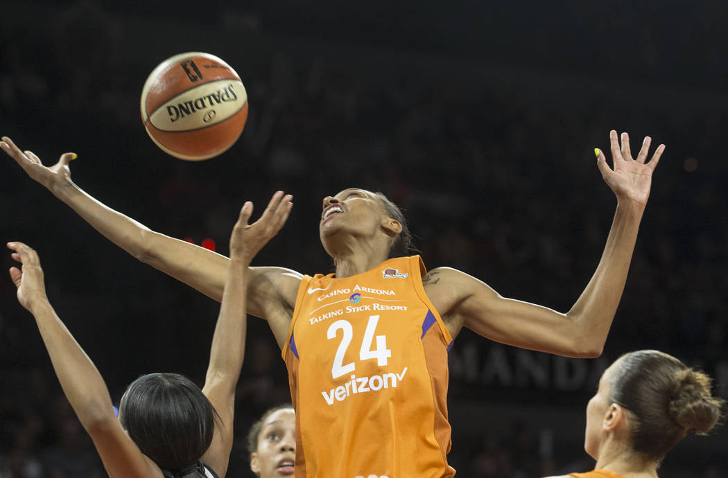 Mercury forward DeWanna Bonner (24) fights for a loose ball in second quarter during Phoenix's game with the Las Vegas Aces on Wednesday, August, 1, 2018, at the Mandalay Bay Events Center, in Las ...