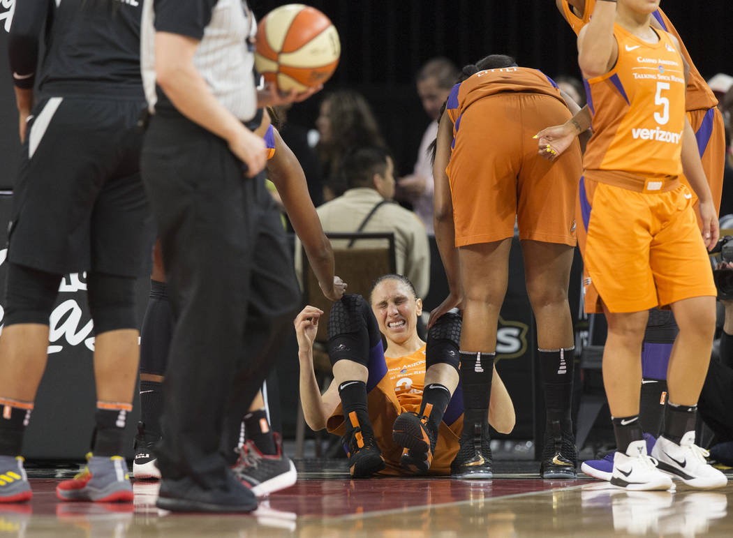 Mercury guard Diana Taurasi (3) gets helped up by teammates after a hard hit in the first quarter during Phoenix's game with the Las Vegas Aces on Wednesday, August, 1, 2018, at the Mandalay Bay E ...