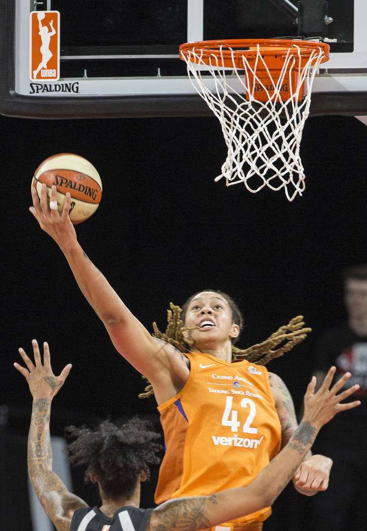 Phoenix Mercury center Brittney Griner (42) drives past Aces forward Tamera Young (1) in the first quarter on Wednesday, August, 1, 2018, at the Mandalay Bay Events Center, in Las Vegas. Benjami ...