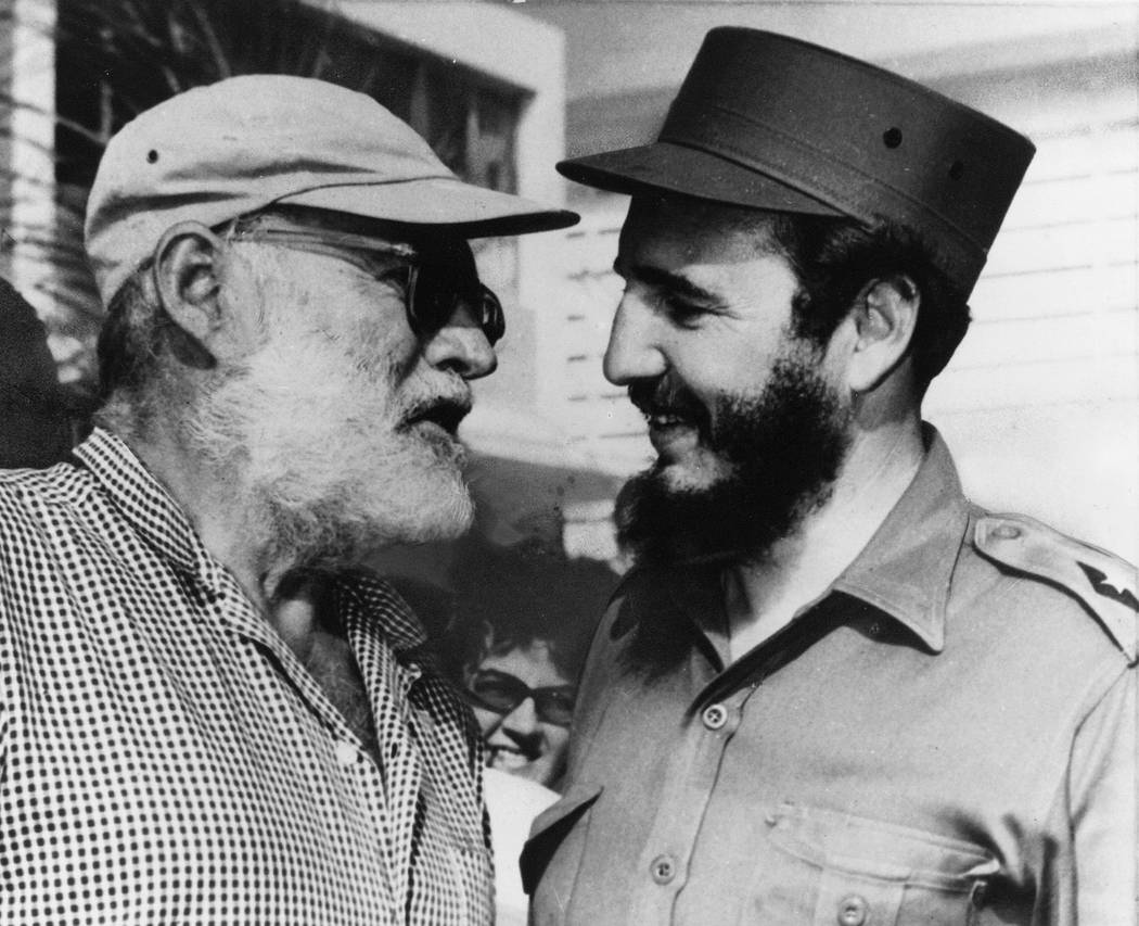 American author Ernest Hemingway (left) and Cuban Prime Minister Fidel Castro, who often went fishing together in Cuba, chat in Havana May 15, 1960, 14 months before Hemingway's death. (AP Photo)