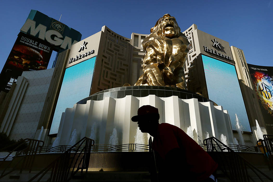 A man rides his bike past the MGM Grand hotel and casino in Las Vegas in 2015. (The Associated Press)
