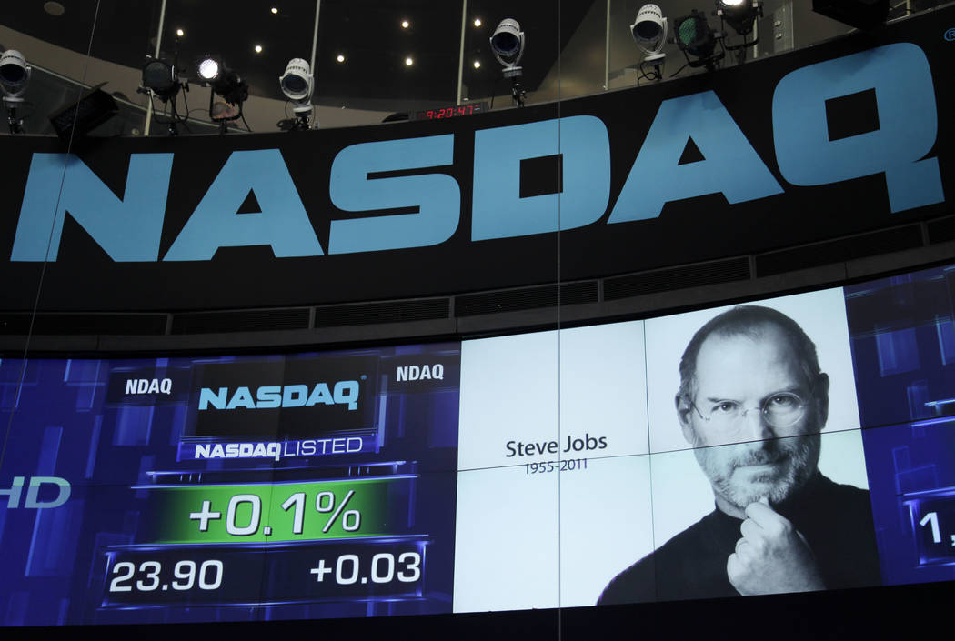 A photo of Apple co-founder Steve Jobs is displayed as a tribute at Nasdaq in New York, Oct. 6, 2011. (Mark Lennihan/AP)